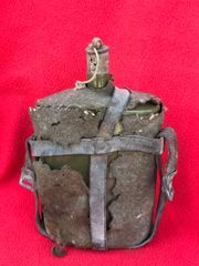 British soldiers rare complete water bottle with 1939 pattern leather carrier found in the basement of a House near Dunkirk from the pocket of may 1940