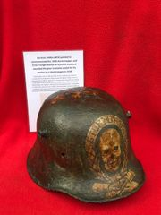 German soldiers M16 helmet painted to commemorate the 1918 stormtroopers and Ernest Junger author of storm of steel and awarded the pour le merite medal for his service