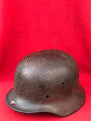 German soldiers M35 helmet very solid smooth finnish with battle damage crack size 62 with maker stamp found on a Brocante in Enidhoven from Operation market garden in 1944