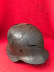 German Soldiers M35 helmet with a lot of Battle damage,solid relic recovered from the Hurtgen Forest in Germany the battlefield of September to December 1944
