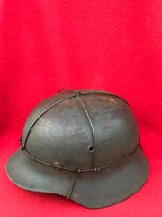 German soldiers M35 helmet with chicken wire,reproduction leather liner,very nice condition,size 64-named found in St Lo in Normandy