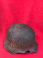 German soldiers M35 helmet double decal with paint remains recovered from near the village of Plota which is south Prokhorovka ware the main tank battle was on the 12th July 1943 in Russia