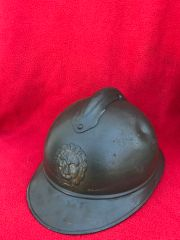 Belgium soldiers M1915 Adrian helmet overpainted green complete with original badge found on a brocante near Ypres from the 1914-1918 battlefield