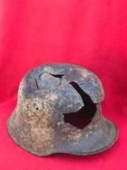 German soldiers M16 helmet with massive battledamage,very solid fantastic relic recovered in Longueval near Delville wood on the 1916 Somme battlefield
