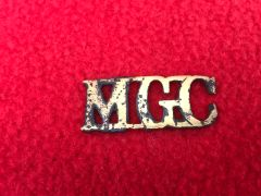 Rare British soldiers machine gun corps shoulder title,semi relic condition recovered many years ago from near Albert on the Somme battlefield of the summer of 1916
