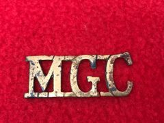Rare British soldiers machine gun corps shoulder title,semi relic condition recovered many years ago from a farm near Albert on the Somme battlefield of the summer of 1916