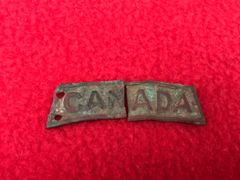 Canadian soldiers of the 2nd Division shoulder title 2 halfs recovered from Red Chateau area in Courcelette captured by the Canadians in September 1916 on the Somme battlefield
