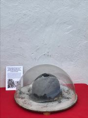 Snow effect dome with mounted US soldiers M1 helmet recovered from near the Elsenborn Ridge in the Ardennes Forest fromthe battle of the bulge in the winter of 1944-1945