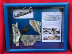 Glass framed airframe and engine parts from German Messerschmitt 410 of 16/KG2 on night intruder raid on London on the 23rd February 1944, shot down crashed at Radnage in Buckinghamshire