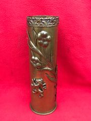 French 75mm shell case trench art with embossed flower and lion design with a crown top found found on the Ypres battlefield 1914-1918 in Belgium