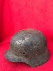 German soldier of the 77th Infantry Division M35 helmet still with some green paint remains and its single decal recovered from Mairle de Pleurtuit a Town which was part of the defence of Saint Malo