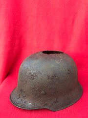 German M34 police helmet,battlefield relic with original paintwork possibly used as a cooking pot recovered from the Demyansk Pocket battlefield in Russia 1941-1942