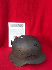 German medical soldiers M42 helmet with red cross remains recovered from near Elsenborn Ridge in the Ardennes Forest from the battle of the bulge 1944-1945
