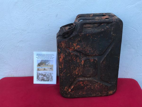 RARE British fuel can with pink paint done in North Africa dated 1943 re painted Green camouflage paintwork,nice condition found at Antwerp used as supply's to the Port for the Allied advance in to Germany in 1944-1945