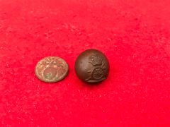 Pair of soldiers small cuff jacket buttons,French and British Artillery both perfect condition found on the Somme battlefield of 1916
