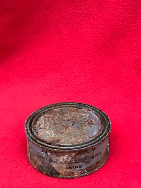 American soldiers shoe cleaning tin still full with contents,original markings recovered from the Woods around Bastogne in, Ardennes Forest 1944-1945