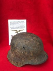 SOLD German soldiers of the 311th Flak battalion M42 steel helmet,some original paintwork found with Tiger 1 tank parts recovered from a Lake East of Bastogne from battle of the Bulge winter 1944-1945