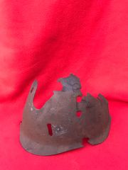 Blown apart section of Russian soldiers SSH40 pattern steel helmet with lots of battle damage recovered from Stalingrad from 1942-1943 battlefield