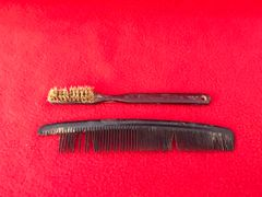 American soldiers hair comb and tooth brush both maker marked recovered from near Elsenborn Ridge in the Ardennes Forest from the battle of the bulge 1944-1945