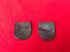 Pair of German soldiers pith helmet badge 3 coloured shields recovered from the battlefield at Monte Cassino in Italy