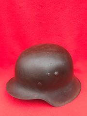 German soldiers M42 steel helmet fantastic condition semi-relic with original black paint work,battle damaged found in Aachen from the September- October 1944 battle to capture the city
