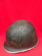 American soldiers M1 steel helmet semi-relic condition,original green paintwork found many years ago in Bastogne in the Ardennes Forest from the battle of the bulge 1944