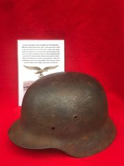 German soldiers of the 311th Flak battalion M40 steel helmet,lot of original paintwork found with Tiger 1 tank parts recovered from a Lake East of Bastogne from battle of the Bulge winter 1944-1945