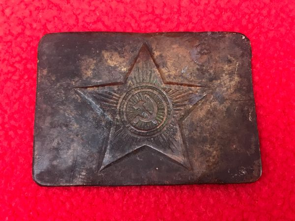 Russian Army soldiers belt buckle brass made with star,relic squashed flat and a bit dirty and discoloured recovered from the battlefield on the Seelow Heights in 1945 the opening battle for Berlin