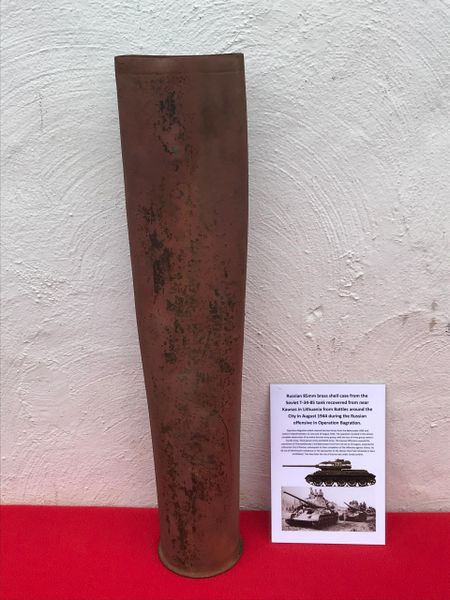 Russian 85mm brass shell case,ink stamped markings, squashed used by T34-85 Tank recovered from Kaunas in Lithuania from Battles around the City in August 1944 during the Russian offensive in Operation Bagration