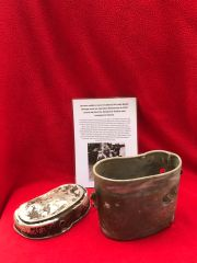 German soldiers mess tin dated 1941 with battle damage,bullet holes,nice condition relic recovered from the Demyansk Pocket south of Leningrad in Russia 1941-1942 battlefield