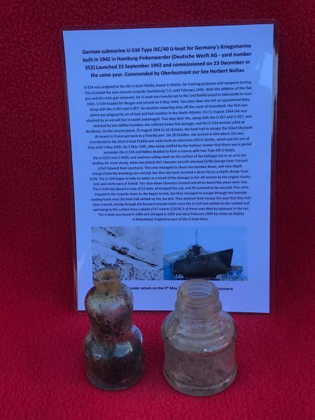 German 2 small clear glass bottles with dirt and muck inside recovered from U-Boat U534 which was sunk on the 5th May 1945