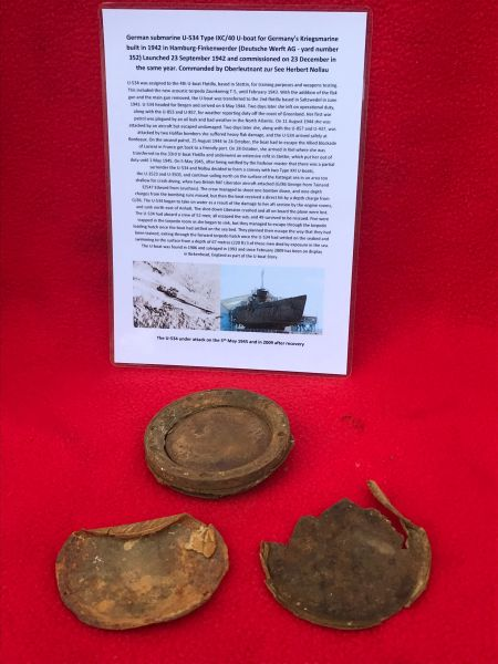 German crewman's gas mask relics,eyelet and eyelet paper covers recovered from U-Boat U534 which was sunk on the 5th May 1945