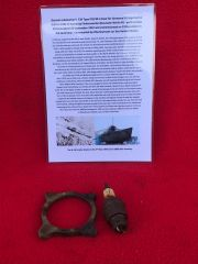 Rare dial face surround and spark plug which is maker marked,made in Germany recovered from the U-Boat U534 which was sunk on the 5th May 1945