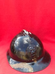 Belgium Army M26 Adrian helmet over painted black for civil defence use,with badge and leather chin strap found in Bruges from the battle of Belgium the May in 1940