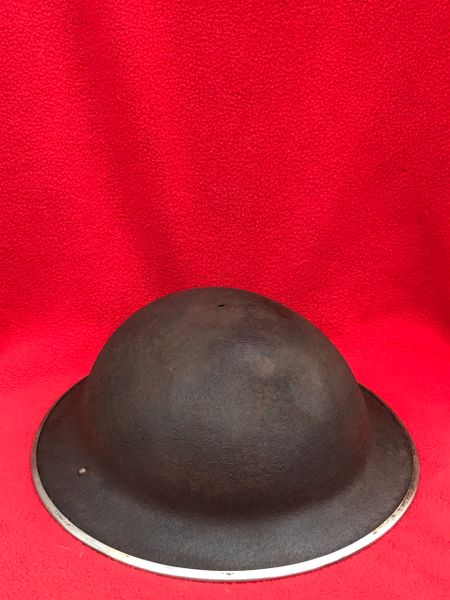 British soldiers Mark 2 Brodie Helmet with mark 3 Chin strap 1941 pattern,nice condition relic found in Bras a village just outside Bastogne this village is were British and American forces both re captured it from the Germans in early 1945