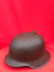 German paratroopers M42 steel helmet,nice solid relic recovered from German Fallschirmjager soldiers fox holes on Hill 192 part of the battle of St Lo in Normandy 1944