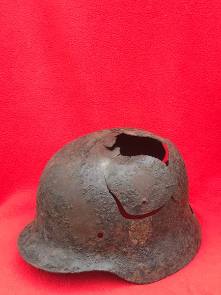 Very rare German Luftwaffe double decal M35 helmet late war over painted black camouflage,battle damaged recovered from in the Woods overlooking Bras near Bastogne,the Ardennes 1944-1945
