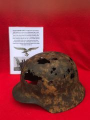 German soldiers of the 311th Flak battalion M35 double decal steel helmet,lot of original paintwork found with Tiger 1 tank parts recovered from a Lake East of Bastogne from battle of the Bulge winter 1944-1945