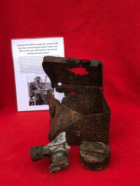 German 8cm Mortar range site remains with markings in its carry box which has sand camouflage paintwork recovered from Death Valley near Hill 112 the battle in operation Epsom on the Normandy battlefield of 1944