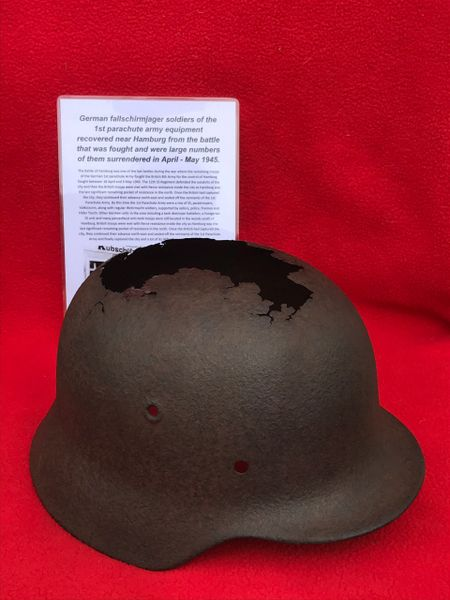 German Fallschirmjager soldier of the 1st parachute army M40 helmet recovered near Hamburg from the battle that was fought and were large numbers of them surrendered in April - May 1945