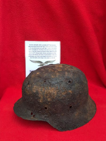 German soldiers of the 311th Flak battalion M42 steel helmet,lot of original paintwork found with Tiger 1 tank parts recovered from a Lake East of Bastogne from battle of the Bulge winter 1944-1945