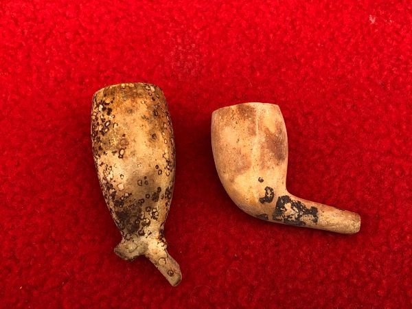 Pair of soldiers smoking pipe ends,nice condition,with burn marks recovered from inside a German bunker near the village of Bucquay which was a German artillery position during the later part of The Somme battle in 1916