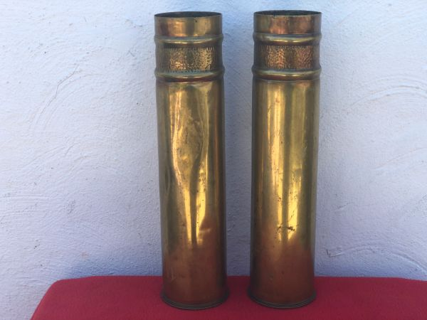 Matching pair of French 75mm brass shell cases trench art embossed lines with pebble dash design the cases are dated 1914 and 1917 found on the Somme battlefield