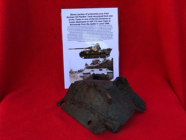 Large section of ripped and bent with impact damage armoured plate from German Panther tank from SS Division or Corps Tank which was defending Hill 112 near Caen in Normandy 1944 battle