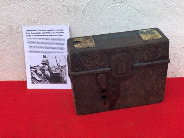 German Field telephone model 33 still in its bakerlite case recovered from Death Valley near Hill 112 the battle in operation Epsom on,Normandy battlefield of 1944