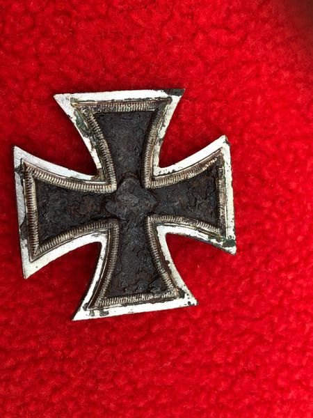 German iron cross 1st class,nice condition relic recovered from a field near the village of Trun a pit dug by the allies where lots of German equipment was buried after the battle in Falaise Pocket,Normandy 1944