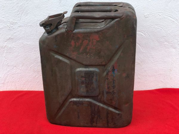 British fuel can or better known the famous Jerry can dated 1945 with the War Department arrow,with a part red over paint found on a Brocante in Enidhoven from Operation market garden and battles in Holland in late 1944