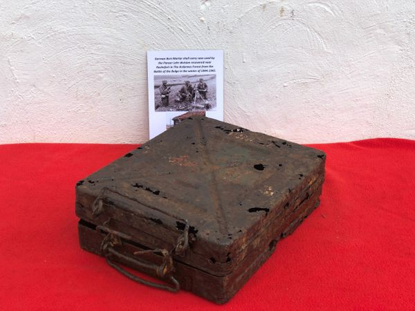 German 8cm Motar shell carry case in relic condition,some original paintwork,markings also has paper label used by the Panzer Lehr division recovered from near Rochefort which was a village attacked on the 23rd December 1944,The Ardennes