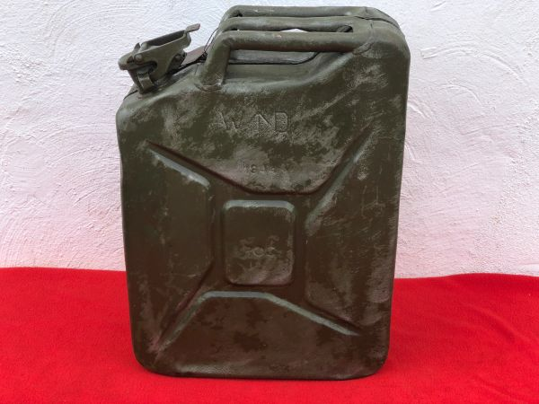 British fuel can or better known the famous Jerry can dated 1944,maker marked with original green paintwork and metal label with recovered on a Farm in the Village of Clecy near Falaise in Normandy