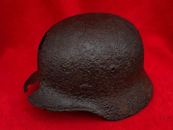 German soldiers M35 helmet with green paint remains,leather liner remains recovered from near the village of Plota which is south Prokhorovka ware the main tank battle was on the 12th July 1943,Russia